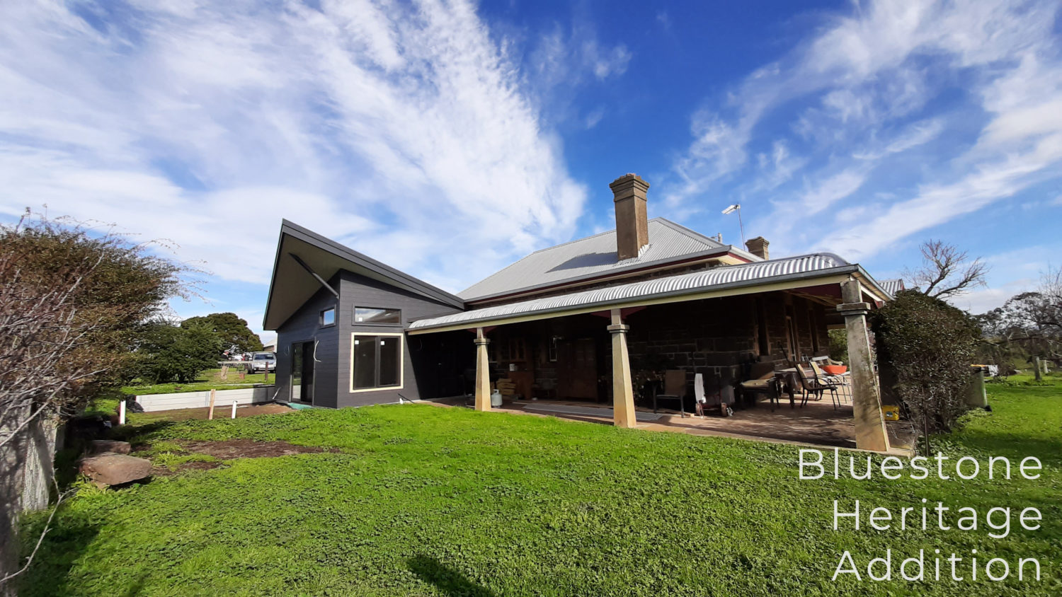 Modern addition to heritage bluestone farmhouse