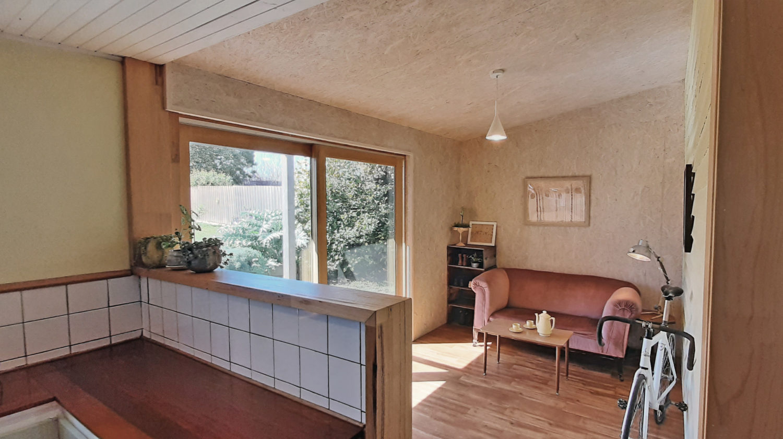 sun room with OSB lining, double-stud walls, solar gain, double-glazed sliding door